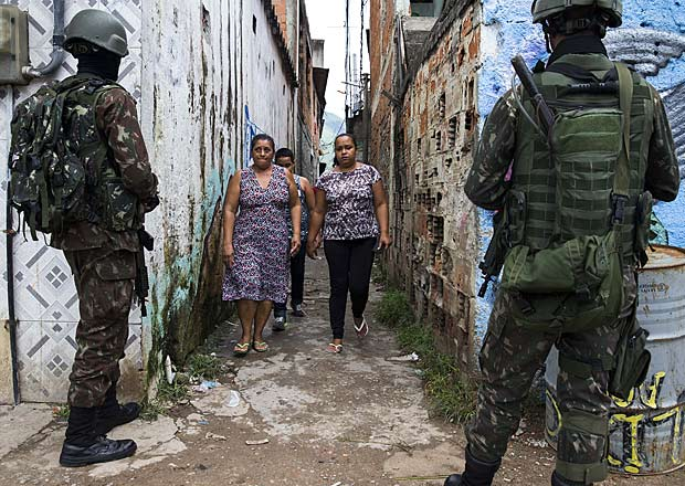 Members of the armed forces patrol the Vila Alianca slum during an operation against crime in Rio de Janeiro
