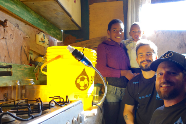 Jon Rose, Guga Ketzer and Jessica after they just gave her access to clean drinking water in Favela Jardim Itapema, Sao Paulo, Brazil, June 12, 2014.Waves of water documentary movie film