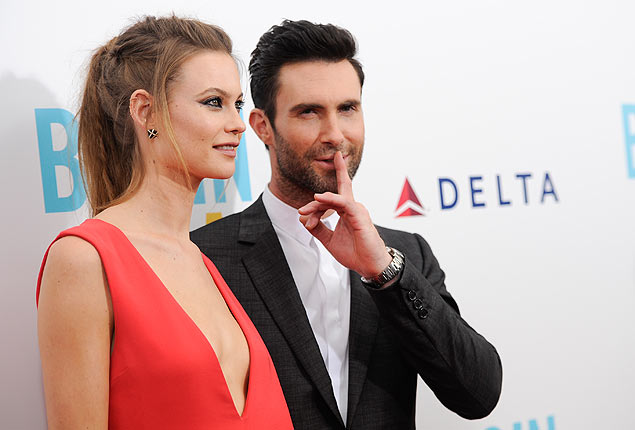 "Adam Levine and fiancee Behati Prinsloo attend premiere of ""Begin Again"" at the SVA Theatre on Wednesday, June 25, 2014 in New York. (Photo by Evan Agostini/Invision/AP) ORG XMIT: NYEA204"