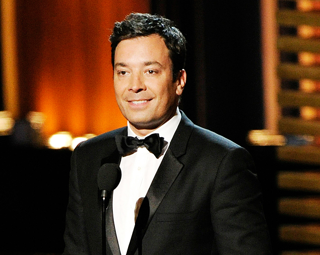 FILE - In this Aug. 25, 2014 file photo, Jimmy Fallon presents an award at the 66th Annual Primetime Emmy Awards in Los Angeles. Fallon is on the shelf following a hand injury that required minor surgery Friday and forced NBC to cancel a taping of his late-night TV program,