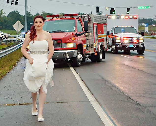 How dedicated are you to your job? Sarah Ray, Paramedic with Montgomery County Emergency Medical Services, was photographed on her wedding night working the wreck of one of her wedding guests. Now that's dedication...she stopped to assist on the way from the wedding to the reception! Thank you, Sarah, for loving what you do! -- https://www.facebook.com/mcgtn/photos/a.168153596545128.46304.165365073490647/1213571998669944/?type=3&theater