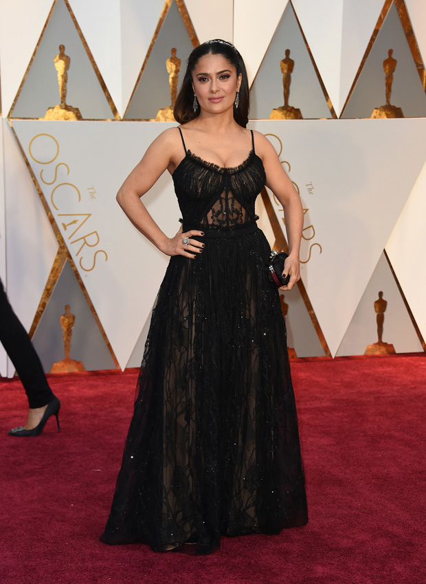 Salma Hayek arrives at the Oscars on Sunday, Feb. 26, 2017, at the Dolby Theatre in Los Angeles. (Photo by Jordan Strauss/Invision/AP) ORG XMIT: NYET120