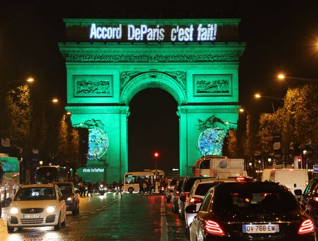 The Arc de Triomphe is lit in green in Paris, France on Nov. 4, 2016 to celebrate the entry into force of the Paris Agreement on climate change.