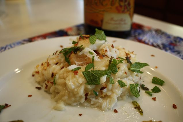 Lemon and crab risotto, garnished with mint and red pepper flakes, is an inspired way to use some of your leftover champagne or sparkling wine. Credit: Copyright 2015 Emily Grosvenor