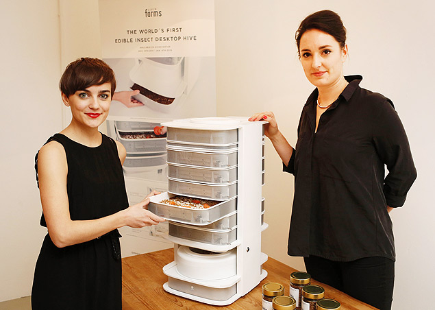 """CORRECTION - TO GO WITH AFP STORY BY SIMON STURDEE - Katharina Unger (L) and Julia Kaisinger (R) are pictured with their """"Hive"""", a machine to produce edible mealworms, Vienna, on January 7, 2016. Young Austrian entrepreneurs Katharina Unger and Julia Kaisinger, 25 and 28, have developed a device to breed in the comfort of your own home the protein-rich grubs of the meal beetle, to then eat. / AFP / Dieter Nagl / """"The erroneous mention[s] appearing in the metadata of this photo by Dieter Nagl has been modified in AFP systems in the following manner: [--Katharina Unger (L) and Julia Kaisinger (R) -] instead of [--Katharina Unger (R) and Julia Kaisinger (L) -]. Please immediately remove the erroneous mention[s] from all your online services and delete it (them) from your servers. If you have been authorized by AFP to distribute it (them) to third parties, please ensure that the same actions are carried out by them. Failure to promptly comply with these instructions will entail liability on your part for any continued or post notification usage. Therefore we thank you very much for all your attention and prompt action. We are sorry for the inconvenience this notification may cause and remain at your disposal for any further information you may require."""""""