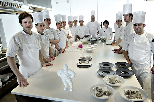 Danish chef Rasmus Kofoed (L) is seen at his restaurant Geranium in Copenhagen, Denmark in this undated photo received by Reuters February 24, 2016. Kofoed received on Wednesday his third Michelin star at Hotel D'Angleterre in Copenhagen. REUTERS/Keld Navntoft/Scanpix Denmark ATTENTION EDITORS - THIS IMAGE WAS PROVIDED BY A THIRD PARTY. FOR EDITORIAL USE ONLY. NOT FOR SALE FOR MARKETING OR ADVERTISING CAMPAIGNS. THIS PICTURE IS DISTRIBUTED EXACTLY AS RECEIVED BY REUTERS, AS A SERVICE TO CLIENTS. DENMARK OUT. NO COMMERCIAL OR EDITORIAL SALES IN DENMARK. NO COMMERCIAL SALES. ORG XMIT: SIN804