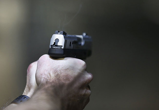 A man fires a Taurus Millennium 9mm at the Ringmasters of Utah gun range, in Springville, Utah on December 18, 2015. REUTERS/George Frey ORG XMIT: SLC11
