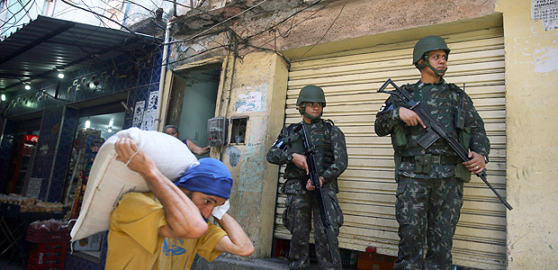 Members of the armed forces patrol the Rocinha slum during an operation against drug gangs in Rio de Janeiro