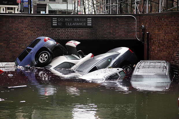 ORG XMIT: NYRD102 Cars are submerged at the entrance to a parking garage in New York's Financial District in the aftermath of superstorm Sandy, Tuesday, Oct. 30, 2012. New York City awakened Tuesday to a flooded subway system, shuttered financial markets and hundreds of thousands of people without power a day after a wall of seawater and high winds slammed into the city, destroying buildings and flooding tunnels. (AP Photo/Richard Drew)