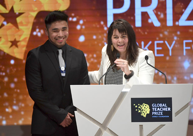 Canadian school teacher Maggie MacDonnell stands next to one of her students after receiving the Global Teacher Prize, in Dubai, United Arab Emirates, Sunday, March 19, 2017. MacDonnell whose teaching philosophy underscores hope and acts of kindness in an isolated corner of Quebec won a $1 million prize in what has become one of the most-coveted and high-profile awards for teaching excellence. MacDonnell beat out thousands of applicants from around the world. (AP Photo/Martin Dokoupil) ORG XMIT: XMD108