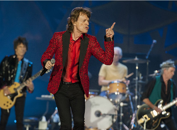 """FILE - In this July 4, 2015 file photo, Ronnie Wood, Mick Jagger, Charlie Watts and Keith Richards of the Rolling Stones perform at the Indianapolis Motor Speedway in Indianapolis. On Thursday, Nov. 5, 2015, the band announced """"The America Latina Olé"""" tour, which will kick off Feb. 3 in Santiago, Chile. (Photo by Barry Brecheisen/Invision/AP) ORG XMIT: NY113"""
