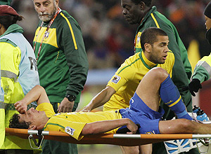 Brazil's Blumer Elano is stretchered off the field after being  injured during the World Cup group G soccer match between Brazil and  Ivory Coast at Soccer City in Johannesburg, South Africa, Sunday, June  20, 2010. (AP Photo/Ivan Sekretarev)