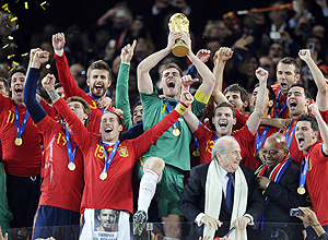 Spain goalkeeper Iker Casillas holds up the trophy after the World Cup final soccer match between the Netherlands and Spain at Soccer City in Johannesburg, South Africa, Sunday, July 11, 2010. Spain won 1-0. (AP Photo/Martin Meissner)