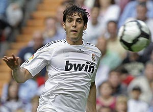 "ORG XMIT: LON105 FILE - Real Madrid's Kaka from Brazil eyes the ball during a Spanish La Liga soccer match against Osasuna at the Santiago Bernabeu stadium in Madrid in this Sunday May 2, 2010 file photo. Madrid manager Jose Mourinho says Kaka is back in training and will return to first-team action next month after knee surgery. The Portuguese coach says he will be back in the squad ""by mid-January."" Kaka trained with the rest of the squad on Saturday Dec 18 2010 for the first time since undergoing surgery on his left knee on Aug. 5. (AP Photo/Paul White, file)"
