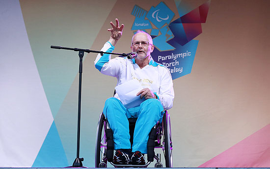 ORG XMIT: OCH104 Paralympian and International Paralympic Committee (IPC) President Philip Craven speaks during the torch relay ceremony at Stoke Mandeville Stadium in Buckinghamshire August 28, 2012. REUTERS/Olivia Harris (BRITAIN - Tags: SOCIETY)
