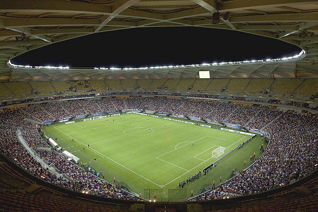 A general view of the Arena Amazonia Vivaldo Lima soccer stadium during the inaugural match between the Nacional and Remo clubs in Manaus, March 9, 2014. The World Cup stadium in the Amazonian city of Manaus was inaugurated Sunday with a ceremony and test match in front of a crowd of 20,000 fans. The stadium is the eighth of the 12 World Cup stadiums to be officially handed over with construction still underway in Curitiba and Sao Paulo, which will host the opening match on June 12. Rebelo sounded confident with one of the most problematic stadiums now more than 97 percent complete. REUTER/Bruno Kelly (BRAZIL - Tags: SPORT SOCCER WORLD CUP) ORG XMIT: BRA106