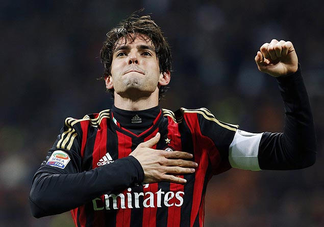 AC Milan's Kaka celebrates after scoring his second goal, the team's third, against Chievo Verona during their Italian Serie A soccer match at San Siro stadium in Milan March 29, 2014. REUTERS/Alessandro Garofalo (ITALY - Tags: SPORT SOCCER) ORG XMIT: AGA112