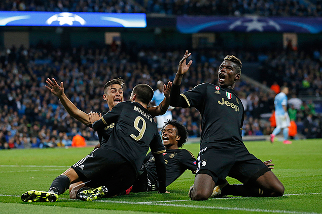Juventus' Alvaro Morata, centre, celebrates with teammates including Paul Pogba, right, after scoring his sides second goal during the Champions League group D soccer match between Manchester City and Juventus at the Etihad Stadium, Manchester, England, Tuesday, Sept. 15, 2015. (AP Photo/Jon Super) ORG XMIT: TH155