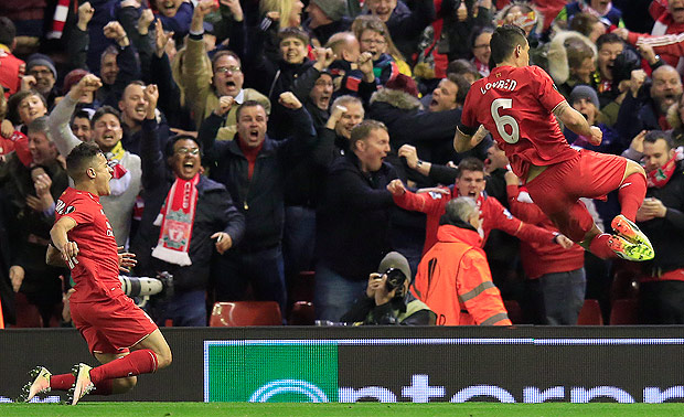 Liverpool's Philippe Coutinho, left, and Liverpool's Dejan Lovren celebrate after scoring the winning goal during the Europa League quarterfinal second leg soccer match between Liverpool FC and Borussia Dortmund in Liverpool, England, Thursday, April 14, 2016. (AP Photo/Jon Super) ORG XMIT: FAS153