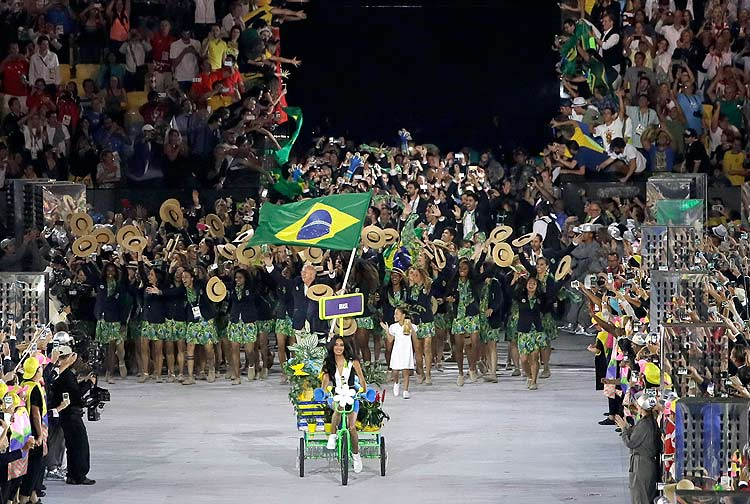 Yane Marques carries the flag of Brazil during the opening ceremony for the 2016 Summer Olympics in Rio de Janeiro, Brazil, Friday, Aug. 5, 2016. (AP Photo/Matt Slocum) ORG XMIT: OLY614