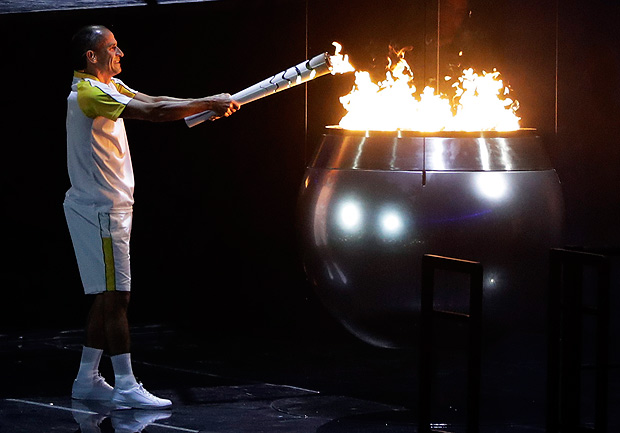 Vanderlei de Lima lights the Olympic flame during the opening ceremony for the 2016 Summer Olympics in Rio de Janeiro, Brazil, Friday, Aug. 5, 2016. (AP Photo/Jae C. Hong) ORG XMIT: OLY749