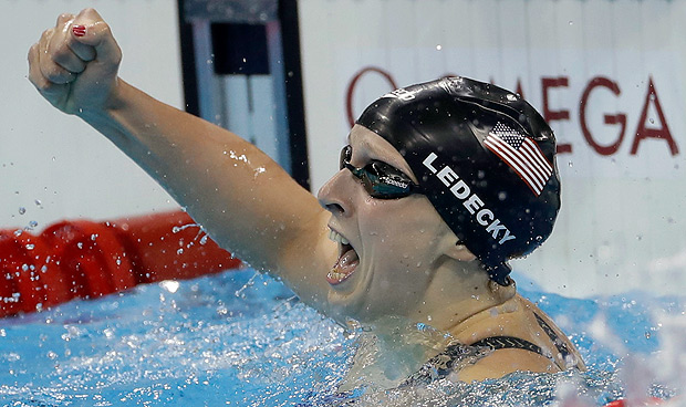United States' Katie Ledecky celebrates winning the gold medal in the women's 400-meter freestyle setting a new world record during the swimming competitions at the 2016 Summer Olympics, Sunday, Aug. 7, 2016, in Rio de Janeiro, Brazil. (AP Photo/Matt Slocum) ORG XMIT: OSWM274