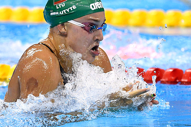 Lithuania's Ruta Meilutyte competes in the Women's 100m Breaststroke Semifinal during the swimming event at the Rio 2016 Olympic Games at the Olympic Aquatics Stadium in Rio de Janeiro on August 7, 2016. / AFP PHOTO / GABRIEL BOUYS