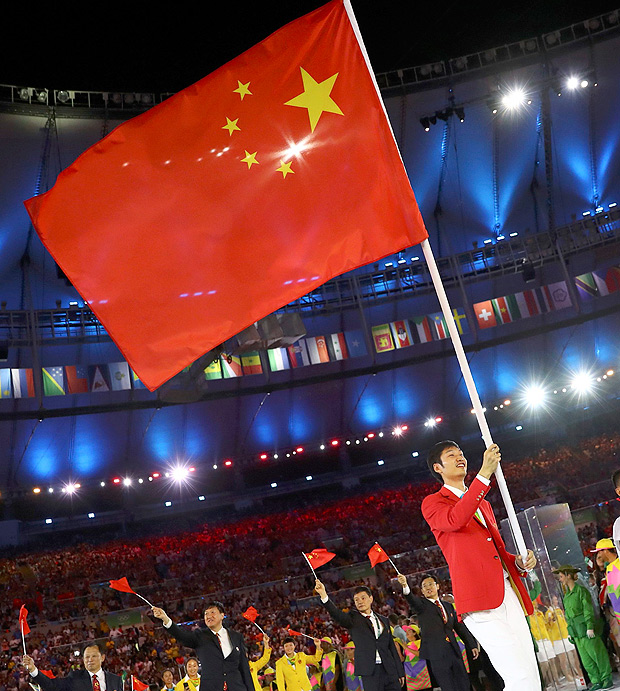 2016 Rio Olympics - Opening Ceremony - Maracana - Rio de Janeiro, Brazil - 05/08/2016. Flagbearer Lei Sheng (CHN) of China leads their contingent at the opening ceremony. REUTERS/Kai Pfaffenbach FOR EDITORIAL USE ONLY. NOT FOR SALE FOR MARKETING OR ADVERTISING CAMPAIGNS. ORG XMIT: SAA35