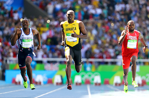 2016 Rio Olympics - Athletics - Preliminary - Men's 100m Round 1 - Olympic Stadium - Rio de Janeiro, Brazil - 13/08/2016. James Dasaolu (GBR) of Britain, Usain Bolt (JAM) of Jamaica and Richard Thompson (TTO) of Trinidad and Tobago compete. REUTERS/Lucy Nicholson FOR EDITORIAL USE ONLY. NOT FOR SALE FOR MARKETING OR ADVERTISING CAMPAIGNS. ORG XMIT: CVI1923