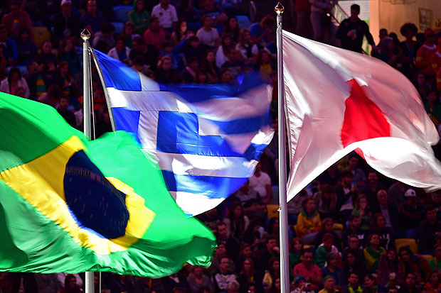 (L-R) The flags of Brazil, Greece and Japan flutter during the closing ceremony of the Rio 2016 Olympic Games at the Maracana stadium in Rio de Janeiro on August 21, 2016. / AFP PHOTO / Jim WATSON