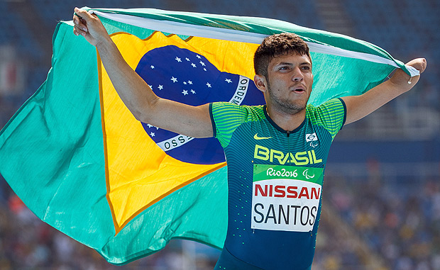 In this photo released by the IOC, Brazil's Petrucio Ferreira dos Santos celebrates taking the gold medal in the Men's 100-meter - T47 final of the Paralympic Games, Rio de Janeiro, Brazil, Sunday, Sept. 11 2016. (Al Tielemans/OIS, IOC via AP) ORG XMIT: XLAT554