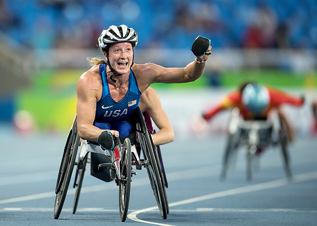 In this photo released by the IOC, gold medallist Tatyana McFadden, of the United States, celebrates finishing first in the women's 5000-meter - T54 final at the Olympic Stadium, during the Paralympic Games in Rio de Janeiro, Brazil, Thursday, Sept. 15, 2016. (Bob Martin/OIS, IOC via AP) ORG XMIT: XLAT737
