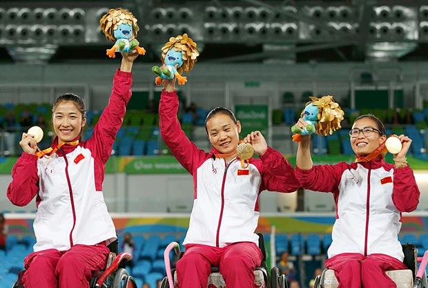 2016 Rio Paralympics - Wheelchair Fencing - Medals Ceremony - Women's Foil Team - Carioca Arena 3 - Rio de Janeiro, Brazil - 16/09/2016. China's Zhang Chuncui, Rong Jing, and Zhou Jingjing at the podium after winning gold. REUTERS/Carlos Garcia Rawlins FOR EDITORIAL USE ONLY. NOT FOR SALE FOR MARKETING OR ADVERTISING CAMPAIGNS. ORG XMIT: SRR67
