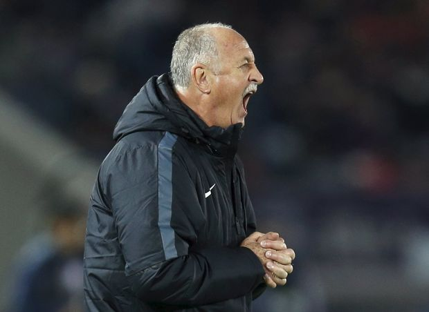 Guangzhou Evergrande's head coach Luiz Felipe Scolari directs his players during their Club World Cup third-place soccer match against Japan's Sanfrecce Hiroshima in Yokohama, south of Tokyo, Japan, December 20, 2015