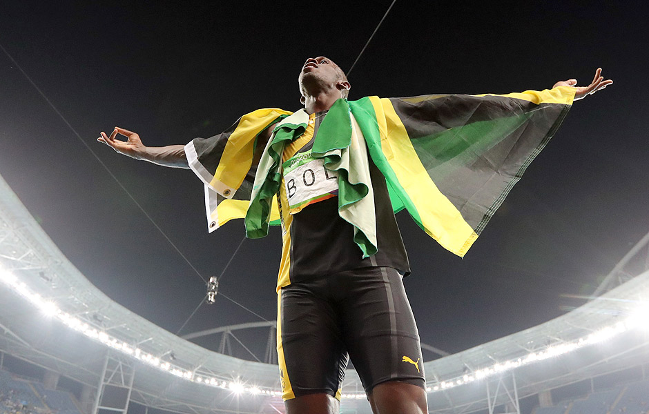 Jamaica's Usain Bolt celebrates winning the gold medal in the men's 4x100-meter relay final during the athletics competitions of the 2016 Summer Olympics at the Olympic stadium in Rio de Janeiro, Brazil, Friday, Aug. 19, 2016. (AP Photo/Lee Jin-man) ORG XMIT: OATH316