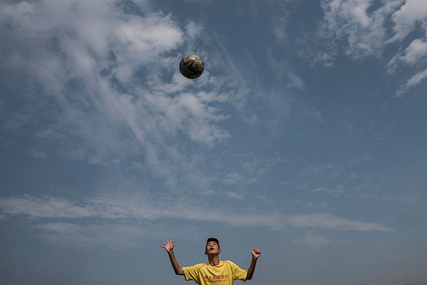 A student practices his headers at the Evergrande Football School, the worldÕs biggest soccer boarding academy, in Qingyuan, China, Dec. 6, 2016. President Xi Jinping has called for for 50,000 schools to have a strong emphasis on soccer by 2025 as China looks to build homegrown talent for the worldÕs most popular sport. (Gilles Sabrie/The New York Times)