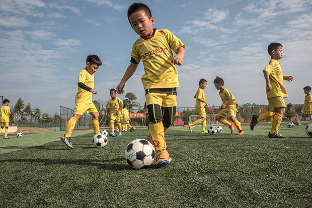 8-year-olds work on their dribbling at the Evergrande Football School in Qingyuan, China, Dec. 6, 2016. As Chinese soccer clubs spend lavishly to lure top players from Europe and South America, an equally ambitious effort is underway to build future generations of homegrown talent via academies like this one, now the the worldÕs biggest soccer boarding school. (Gilles Sabrie/The New York Times)