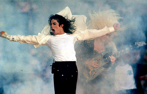 FILE - In this Jan. 31, 1993 file picture, Michael Jackson performs during the halftime show at the Super Bowl XXVII in Pasadena, Calif. The Super Bowl show can easily be divided into two eras: before and after Michael Jackson. His 1993 performance established halftime as something more than an afterthought. With the fireworks and extras, Jackson proved no gesture could be too big. (AP Photo/Rusty Kennedy, File) ORG XMIT: NYET324
