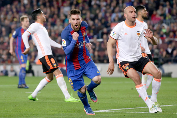FC Barcelona's Lionel Messi, center, celebrates after scoring a goal during the Spanish La Liga soccer match between FC Barcelona and Valencia at the Camp Nou stadium in Barcelona, Spain, Sunday, March 19, 2017. (AP Photo/Manu Fernandez) ORG XMIT: DO131