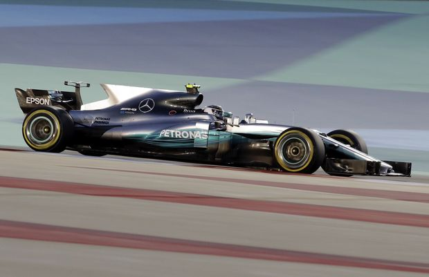 Mercedes driver Valtteri Bottas of Finland steers his car during the qualifying session for the Bahrain Formula One Grand Prix, at the Formula One Bahrain International Circuit in Sakhir, Bahrain, Saturday, April 15, 2017. The Bahrain Formula One Grand Prix will take place on Sunday. (AP Photo/Luca Bruno) ORG XMIT: XAF135