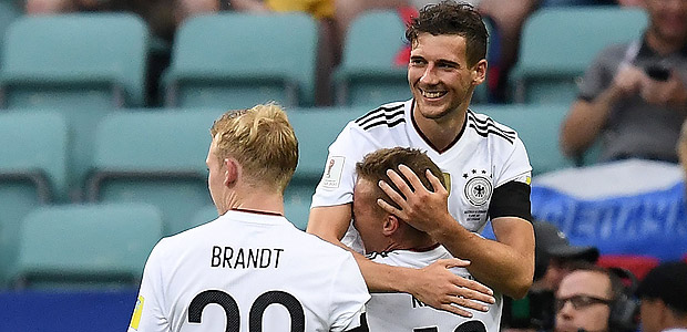 Germany's midfielder Leon Goretzka is congratulated by Germany's defender Joshua Kimmich after he scored a goal during the 2017 Confederations Cup group B football match between Australia and Germany at the Fisht Stadium in Sochi on June 19, 2017. / AFP PHOTO / FRANCK