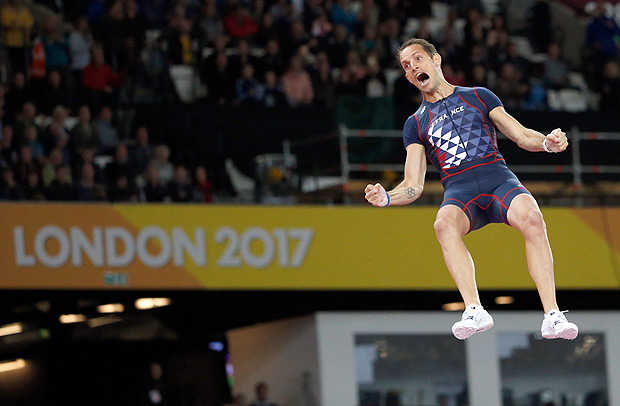 France's Renaud Lavillenie celebrates after an attempt in the men's pole vault final during the World Athletics Championships in London Tuesday, Aug. 8, 2017. (AP Photo/Matthias Schrader) ORG XMIT: WTF409