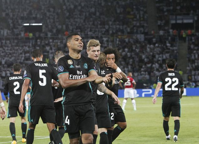 Real Madrid's Casemiro, front, celebrates with teammates after scoring the first goal of his team against Manchester United during the UEFA Super Cup final soccer match between Real Madrid and Manchester United at Philip II Arena in Skopje, Tuesday, Aug. 8, 2017. (AP Photo/Boris Grdanoski) ORG XMIT: XPG124