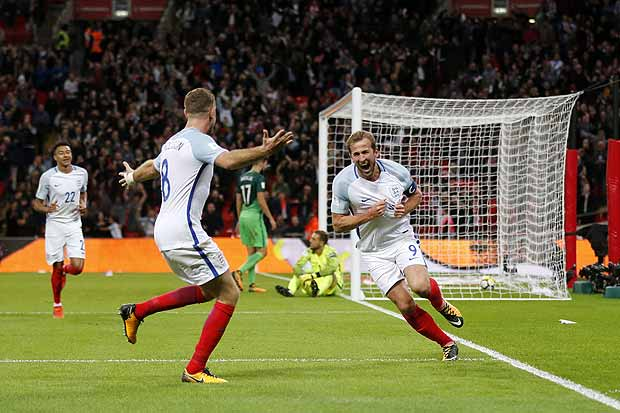 England's Harry Kane, right, celebrates after scoring the opening goal of his team during the World Cup Group F qualifying soccer match between England and Slovenia at Wembley stadium in London, Thursday, Oct. 5, 2017. England won 1-0. (AP Photo/Frank Augstein) ORG XMIT: XTS136