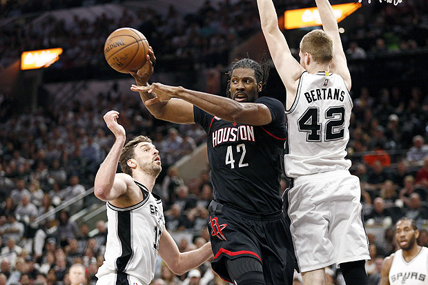May 1, 2017; San Antonio, TX, USA; Houston Rockets center Nene Hilario (42) looks to pass the ball as San Antonio Spurs small forward Davis Bertans (42) and Pau Gasol (16) defend during the first half in game one of the second round of the 2017 NBA Playoffs at AT&T Center. Mandatory Credit: Soobum Im-USA TODAY Sports ORG XMIT: USATSI-359208