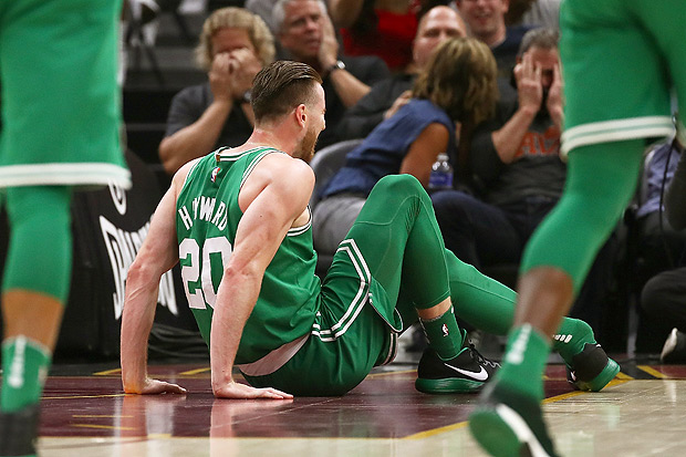 CLEVELAND, OH - OCTOBER 17: Gordon Hayward #20 of the Boston Celtics is sits on the floor after being injured while playing the Cleveland Cavaliers at Quicken Loans Arena on October 17, 2017 in Cleveland, Ohio. NOTE TO USER: User expressly acknowledges and agrees that, by downloading and or using this photograph, User is consenting to the terms and conditions of the Getty Images License Agreement. Gregory Shamus/Getty Images/AFP == FOR NEWSPAPERS, INTERNET, TELCOS & TELEVISION USE ONLY ==