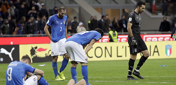 Italian players react to their elimination at the end of the World Cup qualifying play-off second leg soccer match between Italy and Sweden, at the Milan San Siro stadium, Italy, Monday, Nov. 13, 2017. (AP Photo/Luca Bruno) ORG XMIT: PDJ159