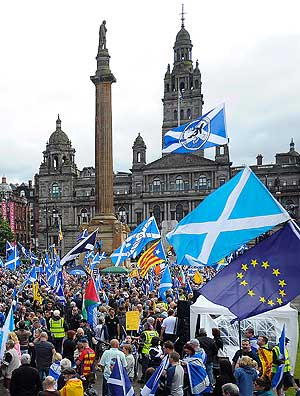 Pro-Scottish Independence supporters with Scottish Saltire flags and EU flags among others rally in George Square in Glasgow, Scotland on July 30, 2016 to call for Scottish independence from the UK. Several thousand pro-independence supporters marched and rallied in central Glasgow calling for Sottish independence from the UK. Independence for Scotland was rejected in a 2014 referendum but the June 2016 EU referendum result in favour of Brexit has ignited a new call for independence. / AFP PHOTO / Andy Buchanan