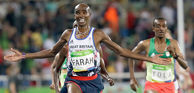 FILE - In this file photo dated Saturday, Aug. 13, 2016, Britain's Mo Farah wins the gold in the men's 10,000-meter final during the 2016 Summer Olympics in Rio de Janeiro, Brazil. Four-time Olympic gold medallist Farah is awarded a Knighthood in the Queen's 2017 New Year Honors. (AP Photo/David J. Phillip, FILE) ORG XMIT: LON111