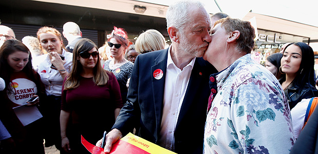 Jeremy Corbyn, the leader of Britain's opposition Labour Party, is kissed by a supporter as he campaigns in Whythenshawe, May 9, 2017. REUTERS/Andrew Yates TPX IMAGES OF THE DAY ORG XMIT: LON275